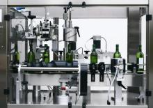 Атоматический капсулатор + нанесение этикетки  до 2500 бут в час